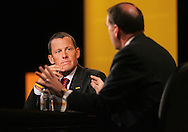 28 August 2007: Seven-time Tour de France winner Lance Armstrong (left) listens to Republican presidential hopeful and former Arkansas governor Mike Huckabee (right) answer a question at the LIVESTRONG Presidential Cancer Forum in Cedar Rapids, Iowa on August 28, 2007.
