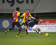 Dundee&rsquo;s Kevin Holt clears despite the attentions of Partick Thistle's Christie Elliot and Abdul Osman - Partick Thistle v Dundee in the Ladbrokes Scottish Premiership at Firhill, Glasgow - Photo: David Young, <br /> <br />  - &copy; David Young - www.davidyoungphoto.co.uk - email: davidyoungphoto@gmail.com
