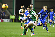 Daniel Candeias and Lewis Stevenson challenge for the ball during the Ladbrokes Scottish Premiership match between Hibernian and Rangers at Easter Road, Edinburgh, Scotland on 8 March 2019.