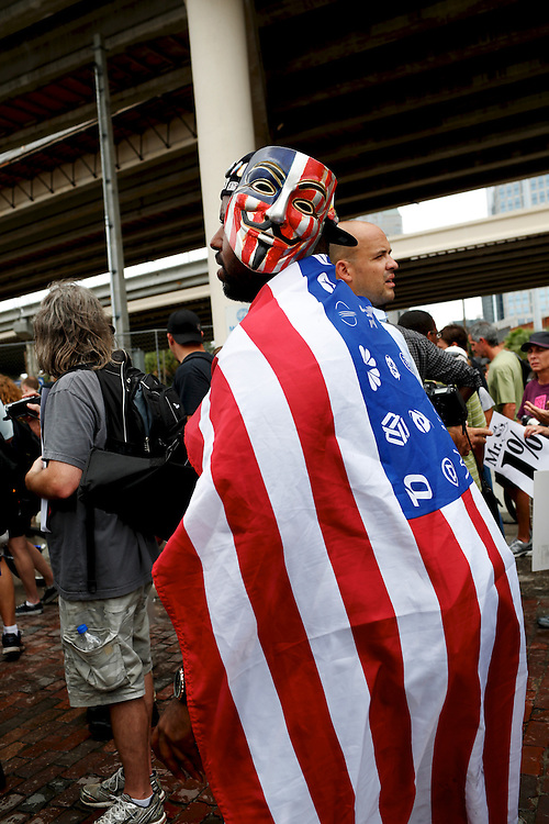Jason Woody, from New York City and a member of Occupy Wall Street, marches with other protesters march through the streets during the 2012 Republican National Convention on August 27, 2012 in Tampa, Fla.