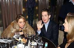 Actor TOM HOLLANDER and DAISY CHASSEY at a party to celebrate the opening of W'Sens - a new fine french restaurant at 12 Waterloo Place, London SW1 on 10th December 2004.<br />