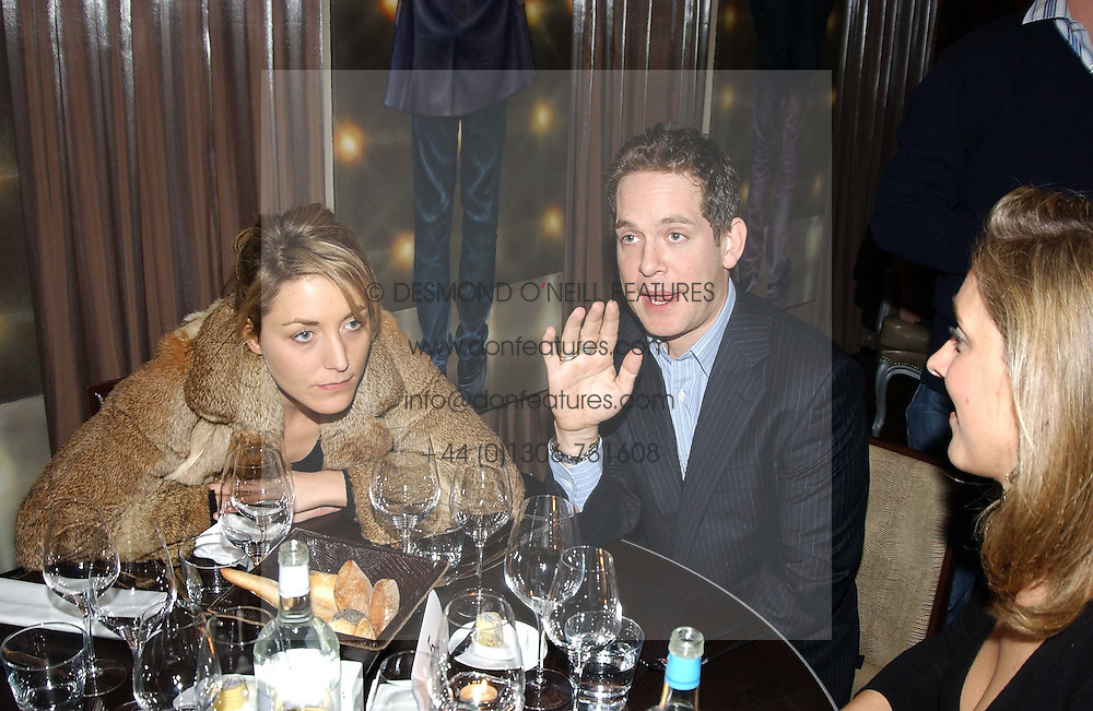 Actor TOM HOLLANDER and DAISY CHASSEY at a party to celebrate the opening of W'Sens - a new fine french restaurant at 12 Waterloo Place, London SW1 on 10th December 2004.<br /><br />NON EXCLUSIVE - WORLD RIGHTS