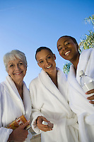 Portrait of three women in bathrobes at health spa