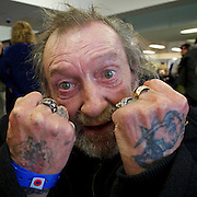 Crisis at Christmas, London, Great Britain <br /> 23rd December 2016 <br /> <br /> First day of operations at one of the Crisis centres in London with a homeless man called John who is often found around the Trafalgar Square area originally from Dover in Kent. <br /> <br /> Crisis at Christmas is a lifeline for thousands of homeless people across the UK, offering support, companionship and vital services over the festive period.<br />  <br /> Crisis at Christmas provides immediate help for homeless people at a critical time - one in four homeless people spends Christmas alone - but our work does not end there. We encourage guests to take up the life-changing opportunities on offer all year round at our centres across the country. <br />  <br /> Crisis is the national charity for homeless people.<br /> <br /> Crisis reveals scale of violence and abuse against rough sleepers as charity opens its doors for Christmas<br /> <br /> People sleeping on the street are almost 17 times more likely to have been victims of violence and 15 times more likely to have suffered verbal abuse in the past year compared to the general public, according to new research from Crisis, the national charity for homeless people.<br />  <br /> <br /> Photograph by Elliott Franks <br /> Image licensed to Elliott Franks Photography Services