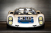 Image of a Porsche 910 race car, #39, at Rennsport Reunion V at Mazda Raceway Laguna Seca, Monterey, California, America west coast. This race car also placed 9th at Le Mans.