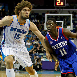 November 7, 2012; New Orleans, LA, USA; Philadelphia 76ers point guard Jrue Holiday (11) drives by New Orleans Hornets center Robin Lopez (15) during the second half of a game at the New Orleans Arena. The 76ers defeated the Hornets 77-62. Mandatory Credit: Derick E. Hingle-US PRESSWIRE