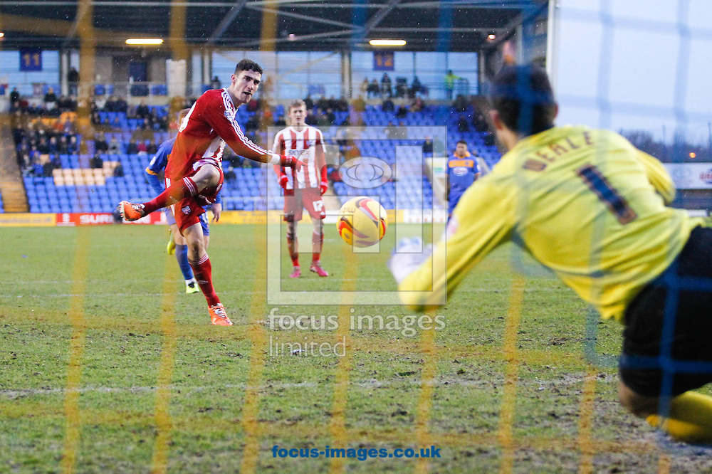 Picture by Mark D Fuller/Focus Images Ltd +44 7774 216216<br /> 01/02/2014<br /> Chris Weale of Shrewsbury Town saves Marcello Trotta of Brentford's initial Penalty Kick during the Sky Bet League 1 match at Greenhous Meadow, Shrewsbury.