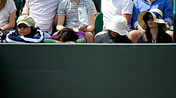 LONDON, ENGLAND - Tuesday, July 1, 2014: Japanese spectators look bored and fall asleep as they wait for the men's 4th round during the Ladies' Singles 4th Round match on day eight of the Wimbledon Lawn Tennis Championships at the All England Lawn Tennis and Croquet Club. (Pic by David Rawcliffe/Propaganda)