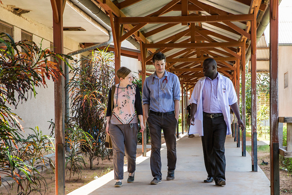VSO volunteers Dr Siobhan Neville and Dr Peter O'Reilly walk through one of the hospital corridors with Dr. Masanja Kasoga head of St Walburg's Hospital, Nyangao. Lindi Region, Tanzania.