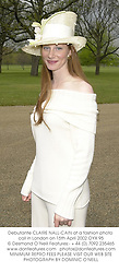 Debutante CLAIRE NALL-CAIN at a fashion photo call in London on 15th April 2002.	OYX 95