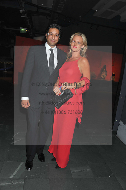 WASIM AKRAM and SHANIERA THOMPSON at The Global Party held at The Natural History Museum, Cromwell Road, London on 8th September 2011.