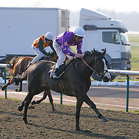 Burke's Rock and Jimmy Fortune winning the 12.35 race