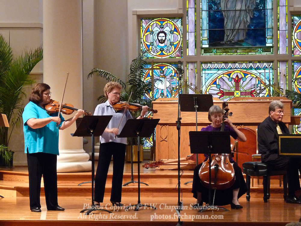 Valley Vivaldi players Mary Ogletree and Rebecca Brown, violins, Deborah Davis, cello, and Allan Birney, harpsichord, perform in a Sunday evening concert starting at 7:30 PM on July 19, 2009 at Wesley Church in Bethlehem, Pennsylvania, USA.