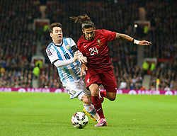 MANCHESTER, ENGLAND - Tuesday, November 18, 2014: Argentina's captain Lionel Messi in action against Portugal's Tiago Gomes during the International Friendly match at Old Trafford. (Pic by David Rawcliffe/Propaganda)