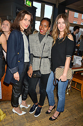 Left to right, LARA BOHINC, SUSAN BENDER and SARA MACDONALD at a quiz night hosted by Zoe Jordan to celebrate the launch of her men's ZJKNITLAB collection held at The Larrick Pub, 32 Crawford Place, London on 20th April 2016.