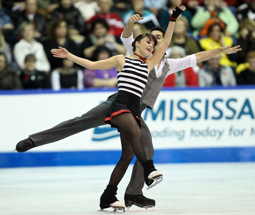 GJR461 -20111030- Mississauga, Ontario,Canada-  Anna Cappellini and Luca Lanotte of Italy perform their free dance at Skate Canada International, in Mississauga, Ontario, October 30, 2011.<br /> AFP PHOTO/Geoff Robins