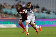 SYDNEY, AUSTRALIA - APRIL 27: Western Sydney Wanderers defender Tarek Elrich (21) and Melbourne Victory forward Kosta Barbarouses (9) battle for the ball at round 27 of the Hyundai A-League Soccer between Western Sydney Wanderers FC and Melbourne Victory on April 27, 2019 at ANZ Stadium in Sydney, Australia. (Photo by Speed Media/Icon Sportswire)