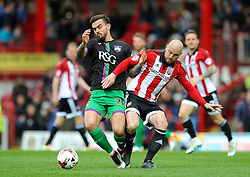 Marlon Pack of Bristol City challenges for the ball with Alan McCormack of Brentford - Mandatory by-line: Dougie Allward/JMP - 16/04/2016 - FOOTBALL - Griffin Park - Brentford, England - Brentford v Bristol City - Sky Bet Championship