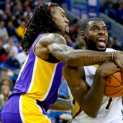 Nov 8, 2013; New Orleans, LA, USA;  New Orleans Pelicans point guard Tyreke Evans (1) drives past Los Angeles Lakers center Jordan Hill (27) during the second quarter of a game at New Orleans Arena. Mandatory Credit: Derick E. Hingle-USA TODAY Sports