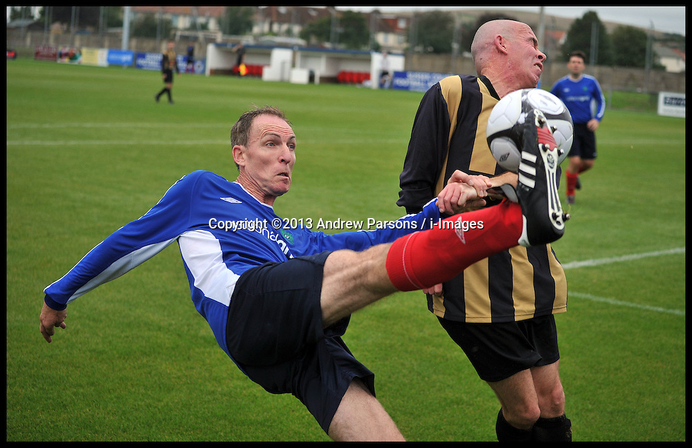 Shadow Secretary of State for Defence Jim Murphy injured while playing in the Labour Politicians v Reporter's Football match at the Labour Party Autumn Conference. Sunday, 22nd September 2013. Picture by Andrew Parsons / i-Images