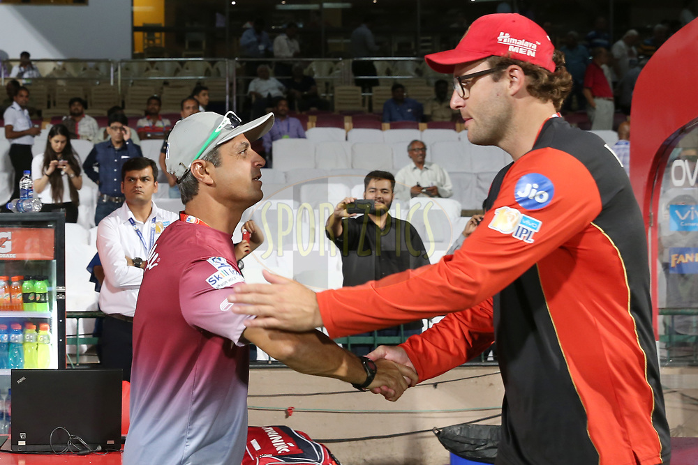 Delhi Daredevils mentor Rahul Dravid greets Head Coach of Royal Challengers Bangalore Daniel Vettori during match 5 of the Vivo 2017 Indian Premier League between the Royal Challengers Bangalore and the Delhi Daredevils held at the M.Chinnaswamy Stadium in Bangalore, India on the 8th April 2017<br /> <br /> Photo by Faheem Hussain - IPL - Sportzpics