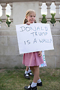 UNITED KINGDOM, London: 03 June 2019<br /> Charlotte Wright, aged 8, joins hundreds of protesters as they gather outside Buckingham Palace to protest against President Donald Trump as he is due to arrive by helicopter at The Queens residence for an official state banquet.