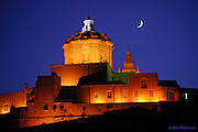 Hand held shot of the moon over the medieval city of Mdina in Malta - &lsquo;The Silent City&rsquo;<br /> <br /> There is so much history here over thousands of years; so heavily influenced by money, power, opposing cultures and religion; attacks, sieges and massacres. Today however, in its current form, it stands as a romantic and beautiful city, a testament to surviving such a rich and dangerous history.