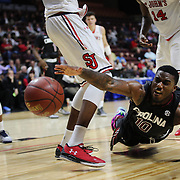 Duane Notice, South Carolina, shows great determination as he fights for a loose ball with Yankuba Sima, (left), and Kassoum Yakwe, St. John's, during the St. John's vs South Carolina Men's College Basketball game in the Hall of Fame Shootout Tournament at Mohegan Sun Arena, Uncasville, Connecticut, USA. 22nd December 2015. Photo Tim Clayton