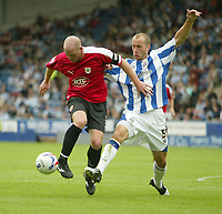 Photo: Aidan Ellis.<br /> Huddersfield Town v Bristol City. Coca Cola League 1. 12/08/2006.<br /> Bristol's Steve Brooker holds off the challenge from huddersfield's David Mirfin
