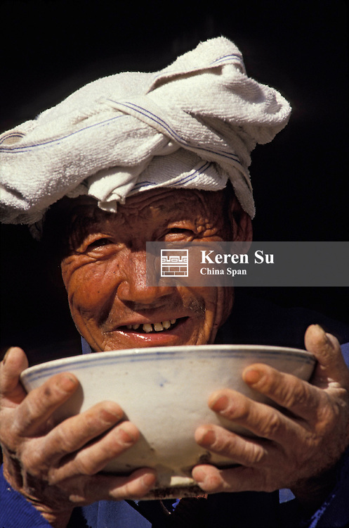 Portrait of a farmer holding a bowl, Shaanxi Province, China