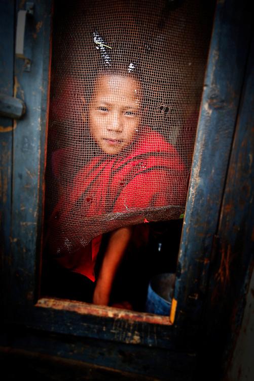 Bhutan, Chimi Lhakhang young monk