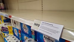 © Licensed to London News Pictures. 11/03/2020. London, UK. A sign on a shelf in a Sainsbury's store in London with advice for the shoppers to 'think before buying' as the store runs out of toilet rolls amid an increased number of cases of Coronavirus (COVID-19) in the UK. Major supermarkets have started to ration certain products after shoppers began to stockpile. Six coronavirus victims have died and 373 cases have tested positive of the virus. Photo credit: Dinendra Haria/LNP