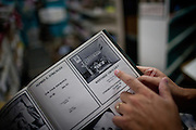 Joe Riofrio points out an advertisement from 1979 for the Westside Grocery in Mendota, Calif., September 10, 2012.