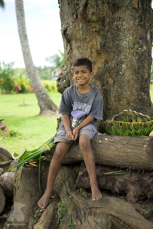 Boy sitting under a mango tree, Koromakawa, Viti Levu island, Fiji.