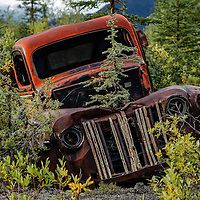 This is one of many abandoned oil field trucks and equipment that is being reclaimed by nature along the N. Canol Rd. in Yukon Canada.