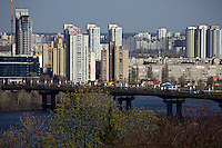 Architectural panorama of the left bank of Dnipro river, with Paton bridge in the foreground. This part of Kyiv city is relatively young, with the majority of buildings made in 1950-1980, however many new sites are under construction as well.