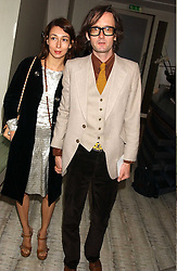 Singer JARVIS COCKER and his wife CAMILLE BIDAULT-WADDINGTON  at a dinner hosted by Arnaud Bamber MD of Cartier, Amanda Sharp and Matthew Slotover Directors of the Frieze Art Fair to celebrate artists featured in the 2005 Frieze Art Fair Curatorial Programme at Nobu-Berkeley, 15th Berkeley Street, London on 21st October 2005.<br />