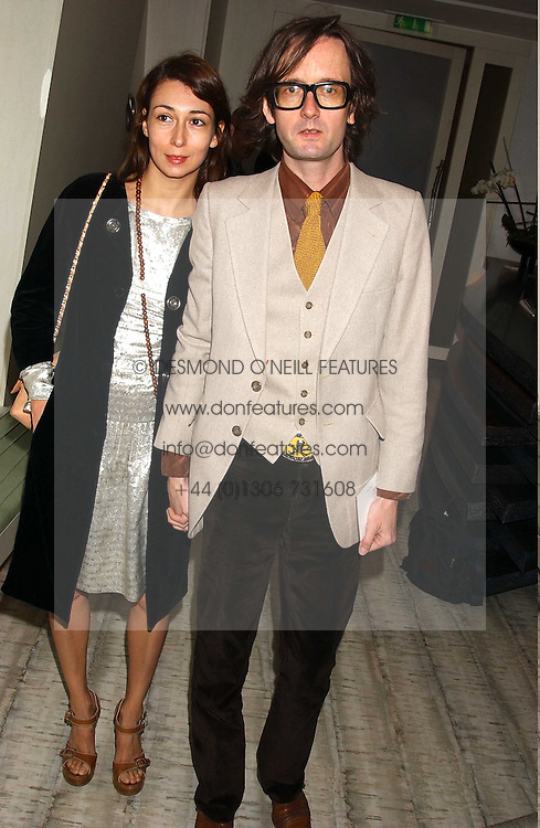 Singer JARVIS COCKER and his wife CAMILLE BIDAULT-WADDINGTON  at a dinner hosted by Arnaud Bamber MD of Cartier, Amanda Sharp and Matthew Slotover Directors of the Frieze Art Fair to celebrate artists featured in the 2005 Frieze Art Fair Curatorial Programme at Nobu-Berkeley, 15th Berkeley Street, London on 21st October 2005.<br /><br />NON EXCLUSIVE - WORLD RIGHTS