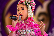 19 APRIl 2014 - BANGKOK, THAILAND: A girl sings traditional Thai folk music at the Rattanakosin Festival in Bangkok. Rattanakosin is the name of the man made island that is the heart of the old city. Bangkok was formally founded as the capital of Siam (now Thailand) on 21 April 1782 by King Rama I, founder of the Chakri Dynasty. Bhumibol Adulyadej, the current King of Thailand, is Rama IX, the ninth King of the Chakri Dynasty. The Thai Ministry of Culture organized the Rattanakosin Festival on Sanam Luang, the royal parade ground in the heart of the old part of Bangkok, to celebrate the city's 232nd anniversary.    PHOTO BY JACK KURTZ