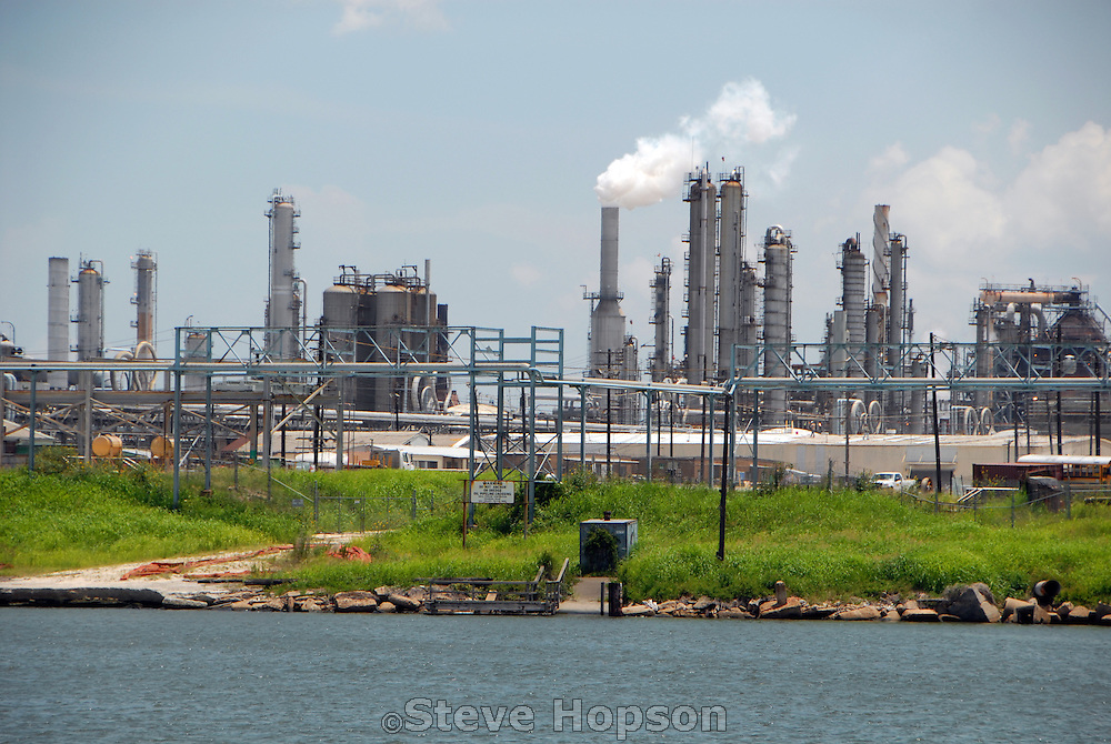 A petrochemical plant on the Houston Ship Channel, July 8 2008. The Houston Ship Channel in Houston, Texas is part of the Port of Houston?one of the United States's busiest sea ports. The channel is a conduit between the continental interior and the Gulf of Mexico for both petrochemical products and Midwestern grain. The original watercourse for the channel, Buffalo Bayou, has its headwaters 30 miles to the west of the city of Houston. It has been used to move goods to the sea since at least 1836. The proximity to Texas oilfields led to the establishment of numerous petrochemical refineries along the waterway, such as the ExxonMobil Baytown installation on the eastern bank of the San Jacinto River.