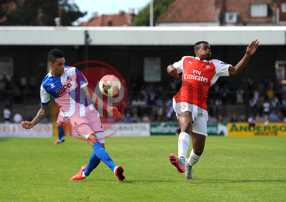 Daniel Leadbitter of Bristol Rovers crosses the ball under pressure from Arsenal's Tyrell Robinson - Photo mandatory by-line: Dougie Allward/JMP - Mobile: 07966 386802 - 18/07/2015 - SPORT - Football - Bristol - Memorial Stadium - Pre-Season Friendly