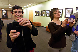 Patty Krise, left, joins in taking photos at a Thanksgiving dinner for soldiers of JBLM held in Chris Knutzen hall of the Anderson University center on Wednesday, Nov. 26, 2014. (Photo/John Froschauer)