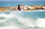 Surfer spins on the crest of a wave Photographed in the Mediterranean Sea, Israel