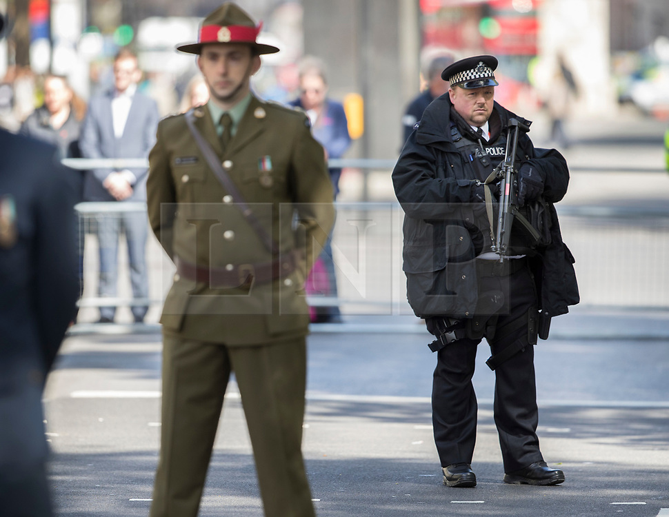 © Licensed to London News Pictures. 25/04/2017. London, UK. An armed policeman stands guard during the ANZAC Day ceremony at the Cenotaph in Whitehall. A dawn ceremony and service was held at The Australian War Memorial and The New Zealand War Memorial at Hyde Park Corner.  April 25th is the day that Australia and New Zealand remember the dead of all wars. Photo credit: Peter Macdiarmid/LNP