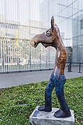 Whimsical statue of moose as people by sculptor Rachelle Dowdy in the sculpture garden at the Anchorage Museum in downtown Anchorage, Alaska.