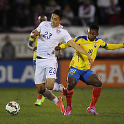 Bobby Shou Wood, (left), USA, is challenged by Jonathan González, Ecuador, during the USA Vs Ecuador International match at Rentschler Field, Hartford, Connecticut. USA. 10th October 2014. Photo Tim Clayton