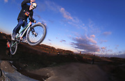 Ricki Gunner on his BMX getting some air from a jump, UK, 2000's