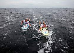 © Licensed to London News Pictures. English Channel. UK 27/07/2011. Nick Thorn (L) and Dave Manley (R). Surf Relief UK paddlers Dave Manley, Nick Thorn, Phil Williams and Toby Lowe paddle surf boards across the 22 miles of the English Channel from Shakespeare Beach, Dover to Cap Gris Nez in France yesterday (26/07/2011). The team smashed their previous predicted 6 hour time, crossing in 5 hours 20 minutes. The team will raise more than £3000 for Surf Relief UK which provides surfing lessoms for disabled and disadvantaged children across the UK. Photo credit: Manu Palomeque/LNP