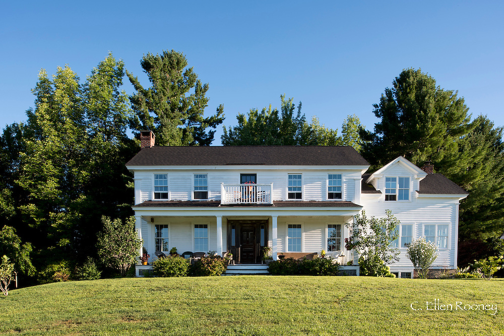 A traditional clapboard country house sitting on a hill in upstate New York. Westerlo, New York, U.S.A.