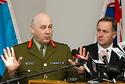Chief of Defence Staff, Lieutenant General Rhys Jones and Prime Minister John Key  at a media conference following the death of two Kiwi Soldiers and several casualties from the Provincial Reconstruction Team in an incident north-east of Bamiyan Province, Afghanistan, Whenuapai Airbase, Auckland, New Zealand, Sunday, August 05, 2012.  Credit:SNPA / David Rowland